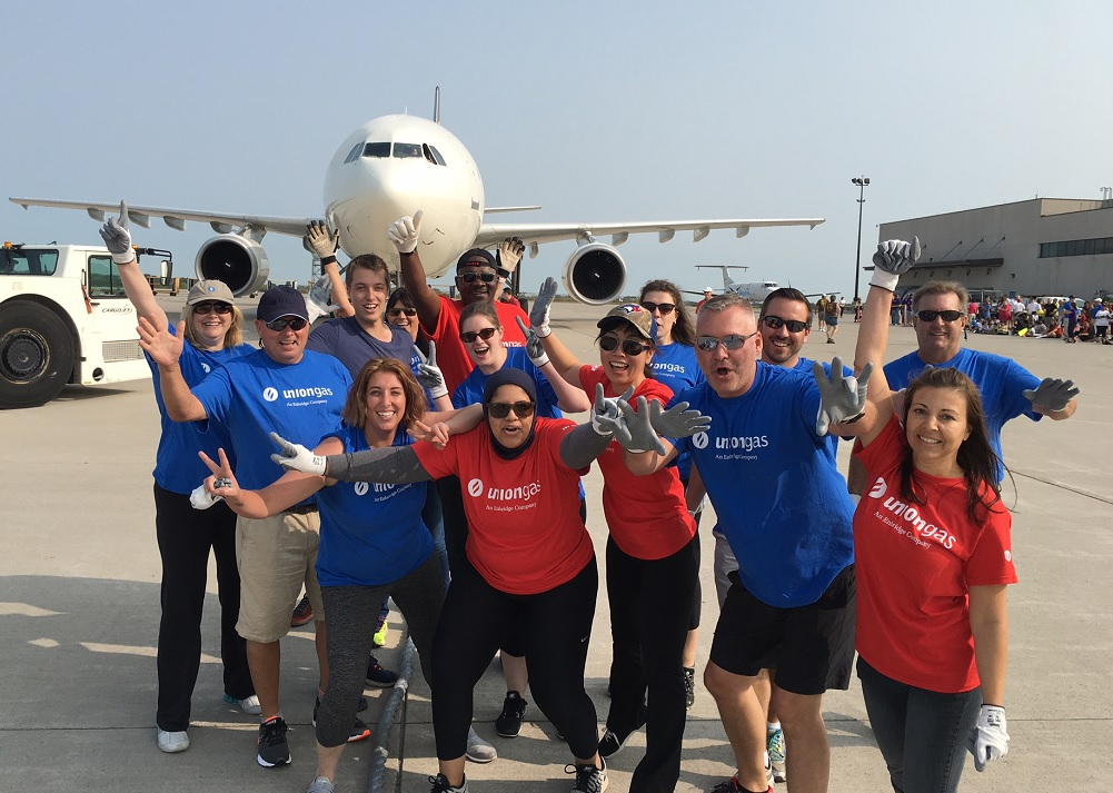 Employees at plane pulling event