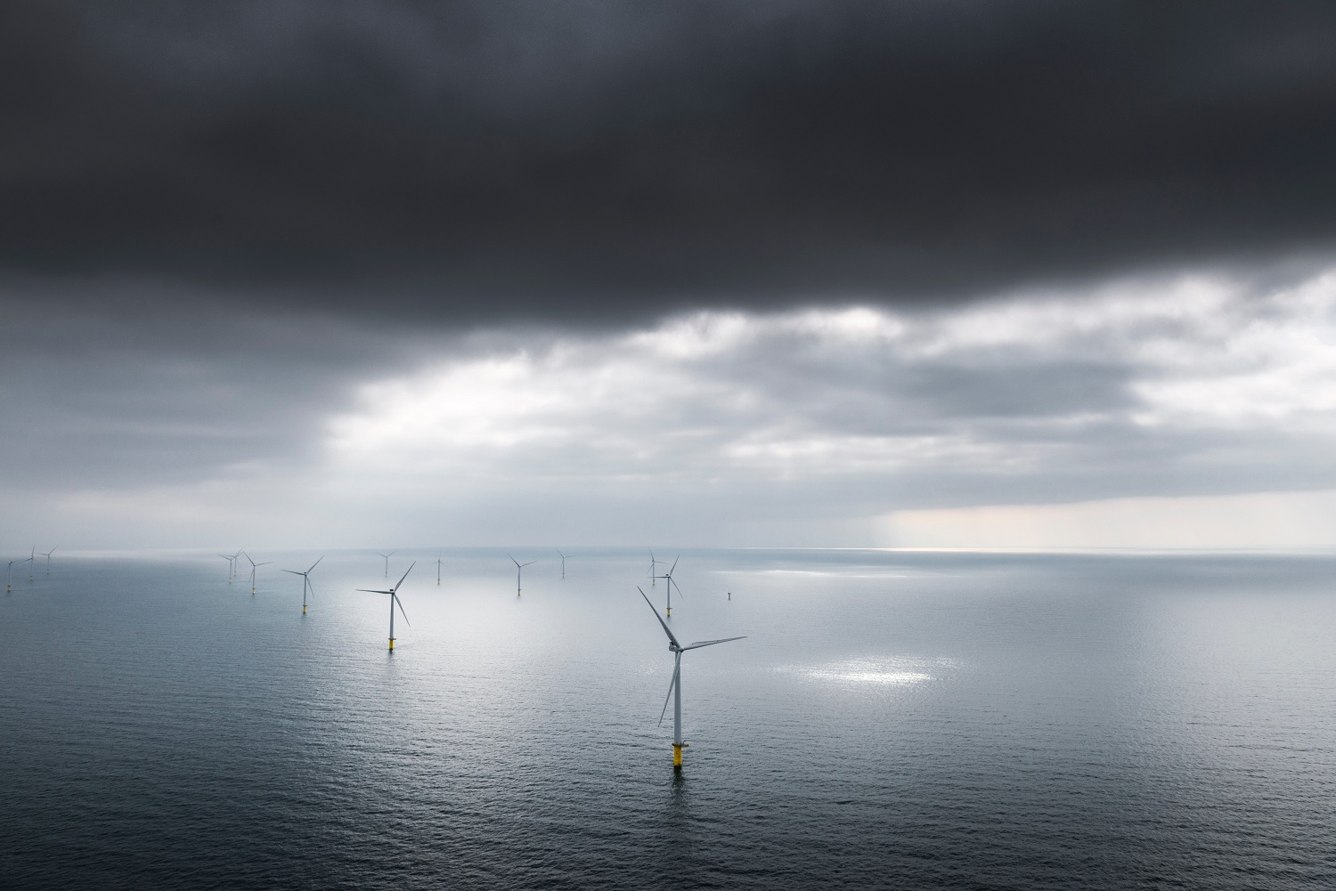 Offshore wind turbines and storm clouds