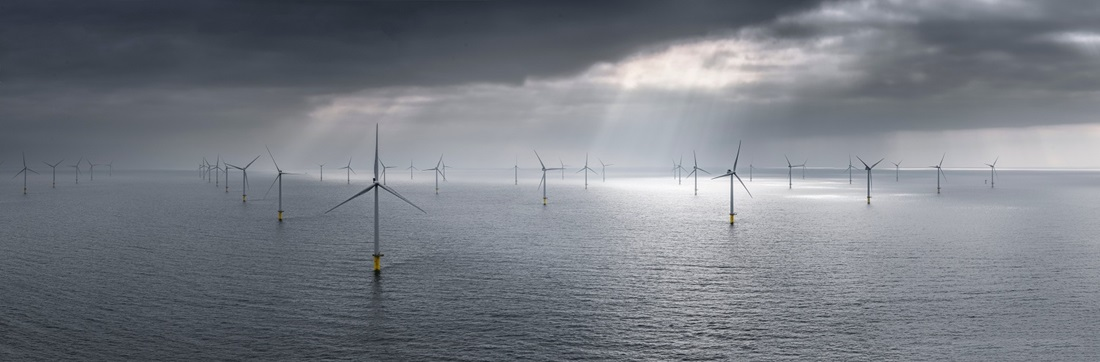 Offshore wind turbines and dark clouds