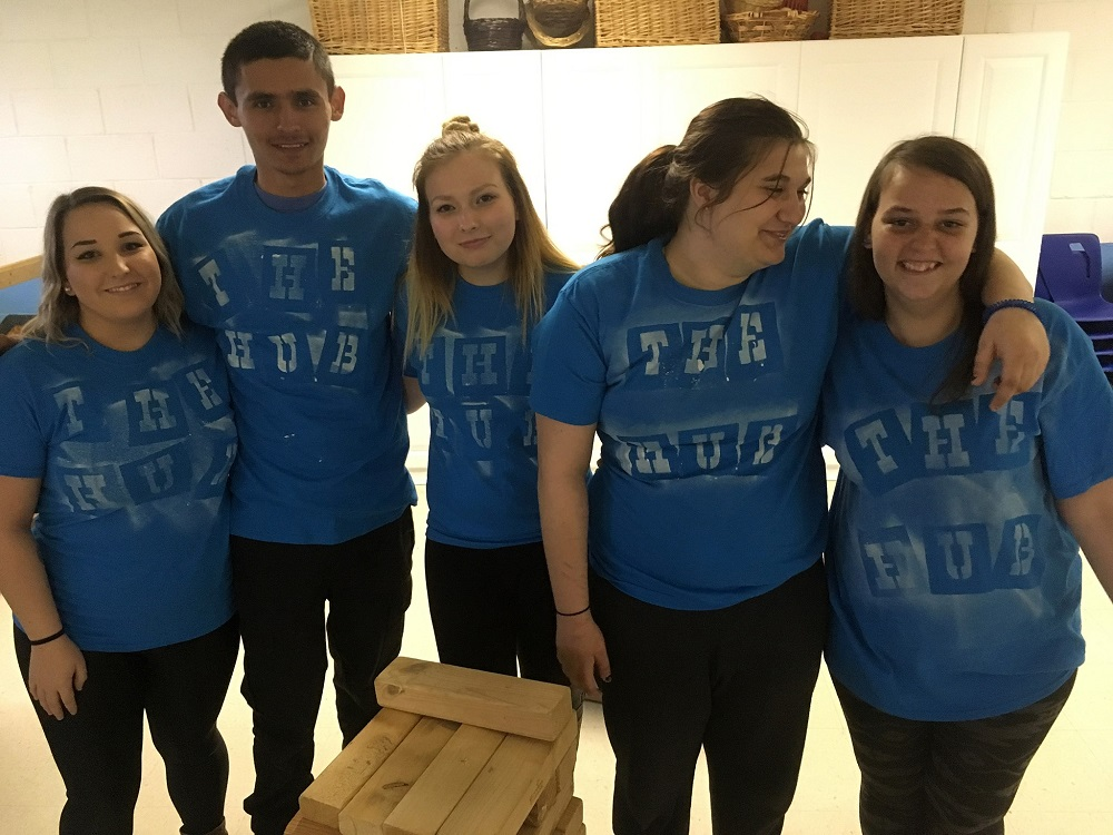 teens in identical blue t-shirts