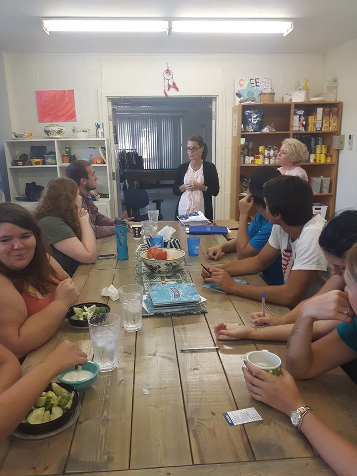 teens eating a meal at youth center
