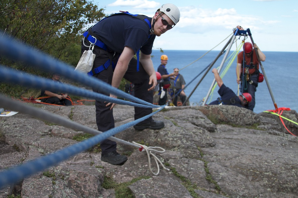 rock climbers with ropes and rigging