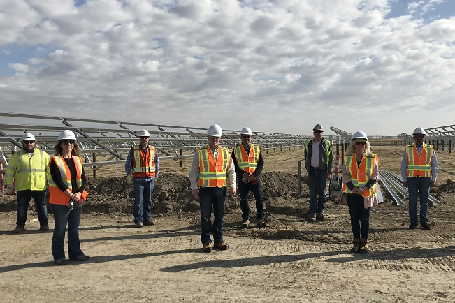Employees at new solar energy facility